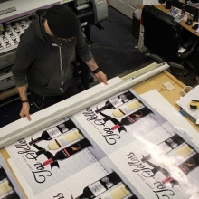 Bird's eye view of Coop cutting large format posters. #regina #yqr #largeformatprinting #bigdaddycoop